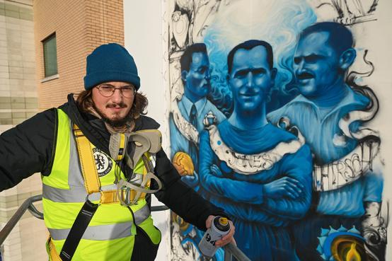 Artist Solomon Souza at the unveiling of his Holocaust memorial mural at Stamford Bridge