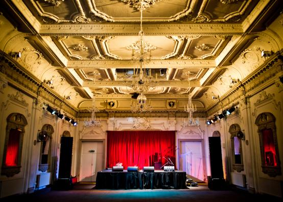 Bush Hall auditorium showing the stage set up for a music gig with microphones and speakers