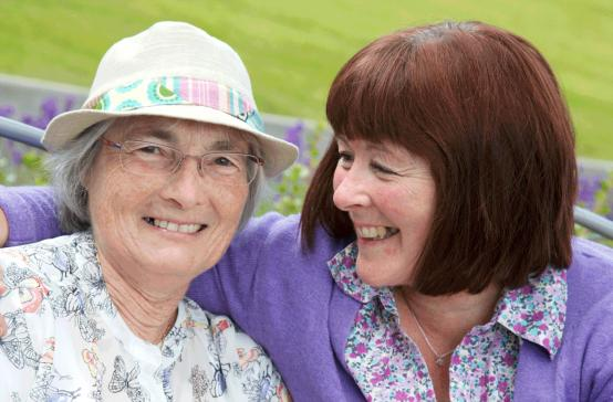 Elderly women with carer
