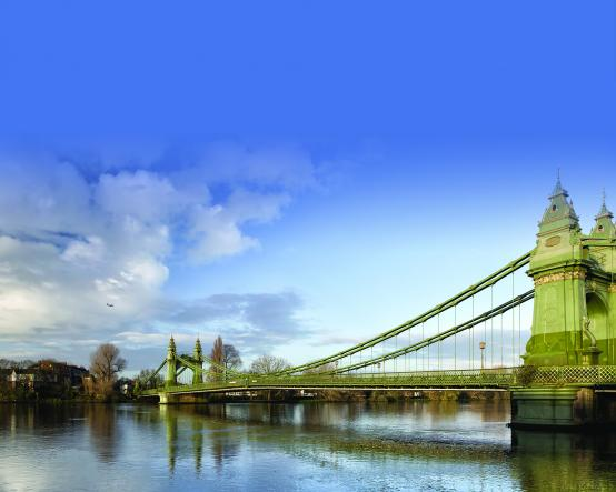 Hammersmith Bridge seen from Hammersmith under a blue sky