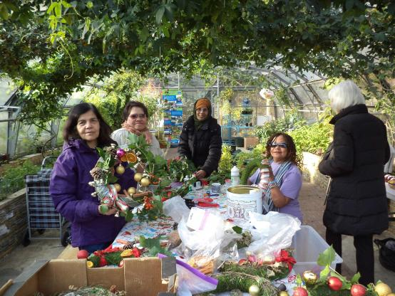 Hammersmith Community Gardens Association members in the greenhouse