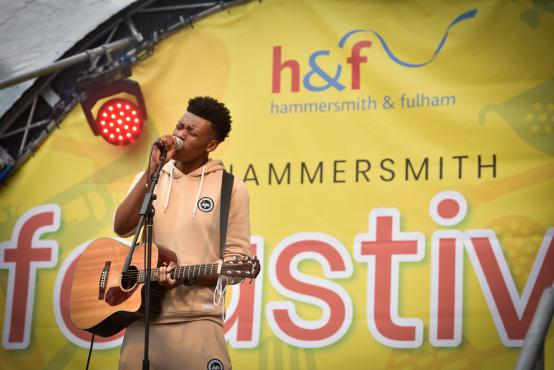 Singer performing on the Hammersmith Feastival music stage in Lyric Square