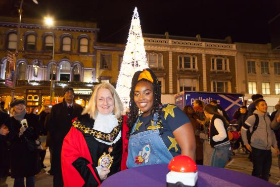 Cllr Daryl Brown and Timmika Ramsay switching on the Christmas lights in Lyric Square, Hammersmith