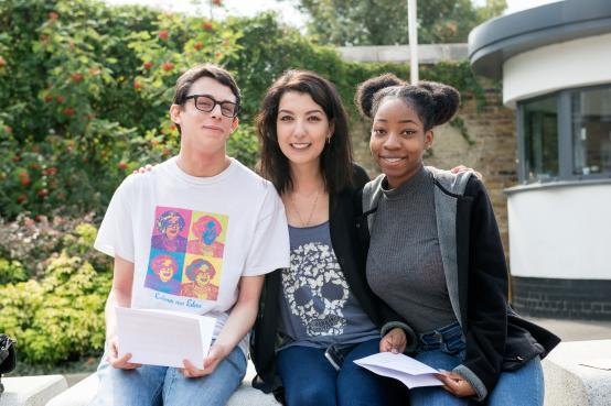 A trio of happy Hammersmith  Academy students