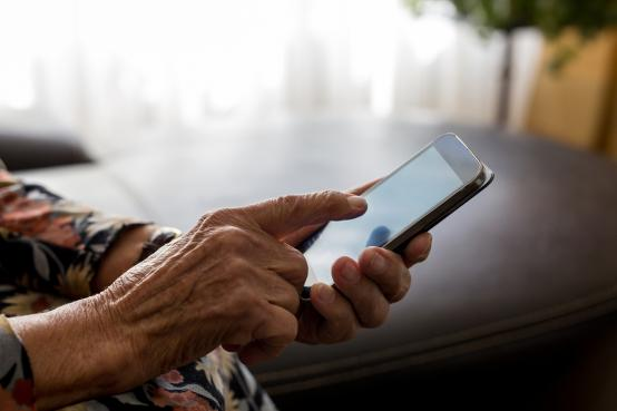 Mobile phone in the hands of an older person