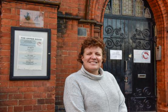 Nicky Flynn standing outside the Upper Room