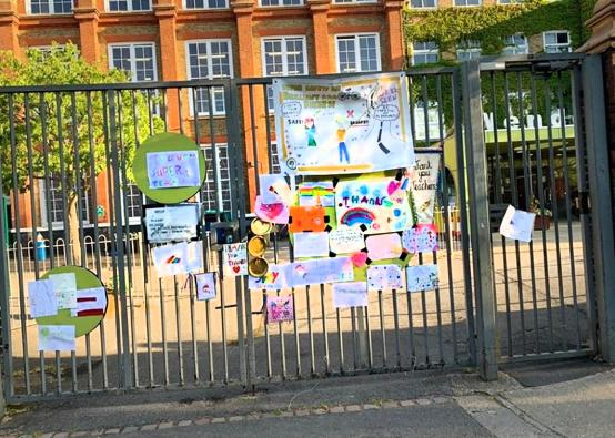 Paintings and pictures of appreciation fastened to the gates of Wendell Park Primary School