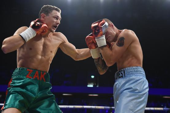 Zak Chelli in boxing action with Adam Jones