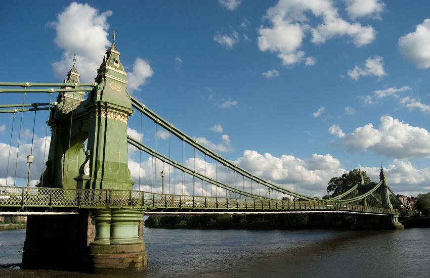 Hammersmith Bridge in front of a blue sky