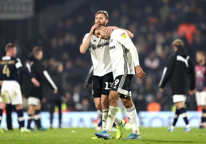 Aleksandar Mitrovic and Tim Ream celebrate at the final whistle against Luton Town