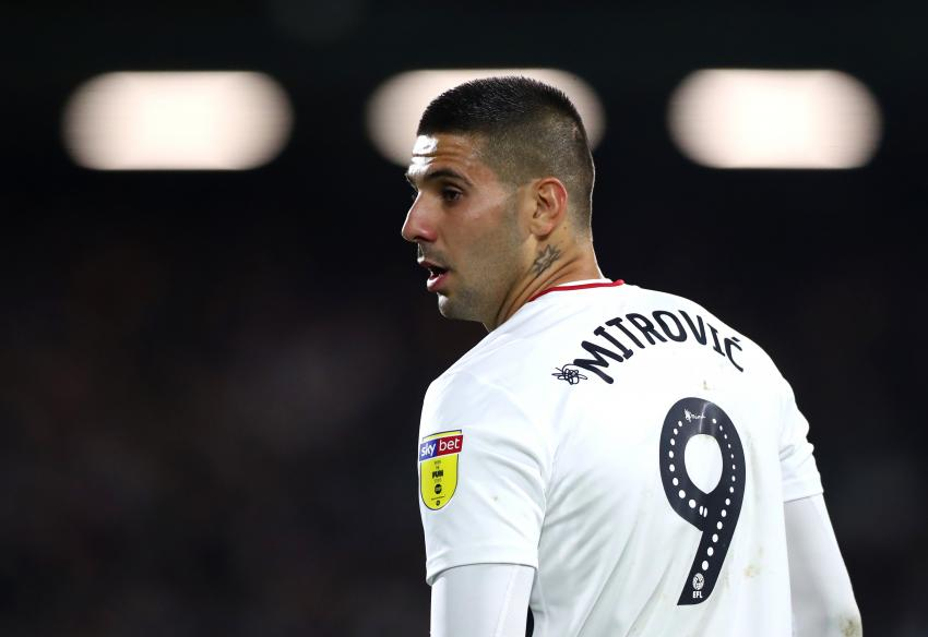 Fulham FC footballer Aleksandar Mitrovic on the pitch in white Fulham FC strip