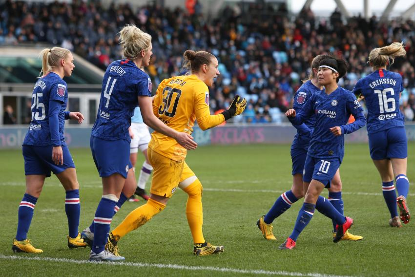 Ann-Katrin Berger celebrates on the pitch with her team mates after saving a penalty