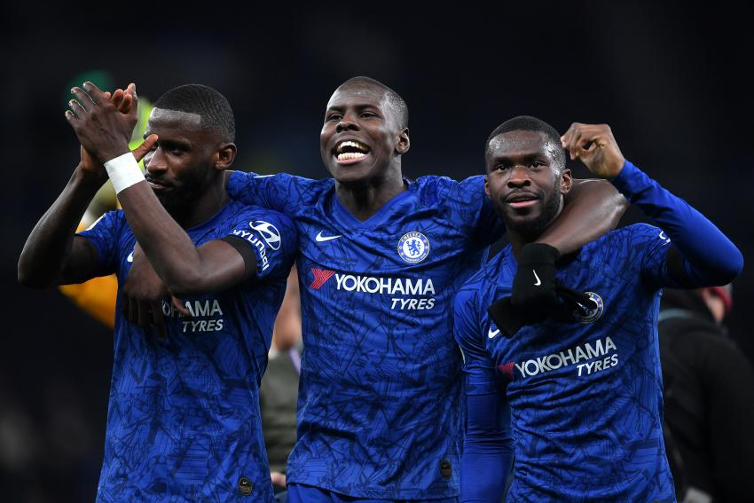 Chelsea players Antonio Rudiger, Kurt Zouma and Fikayo Tomori on the pitch celebrating
