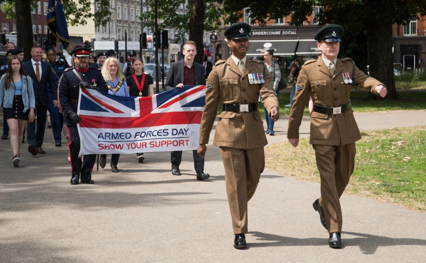 Soldiers from F Rifles Company lead the parade in Shepherds Bush Green