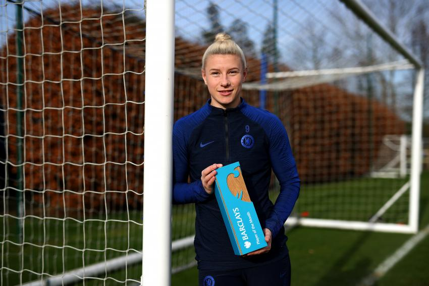 Beth England of Chelsea Women leaning against the goalposts holding her WSL Player of the Month award for January 2020