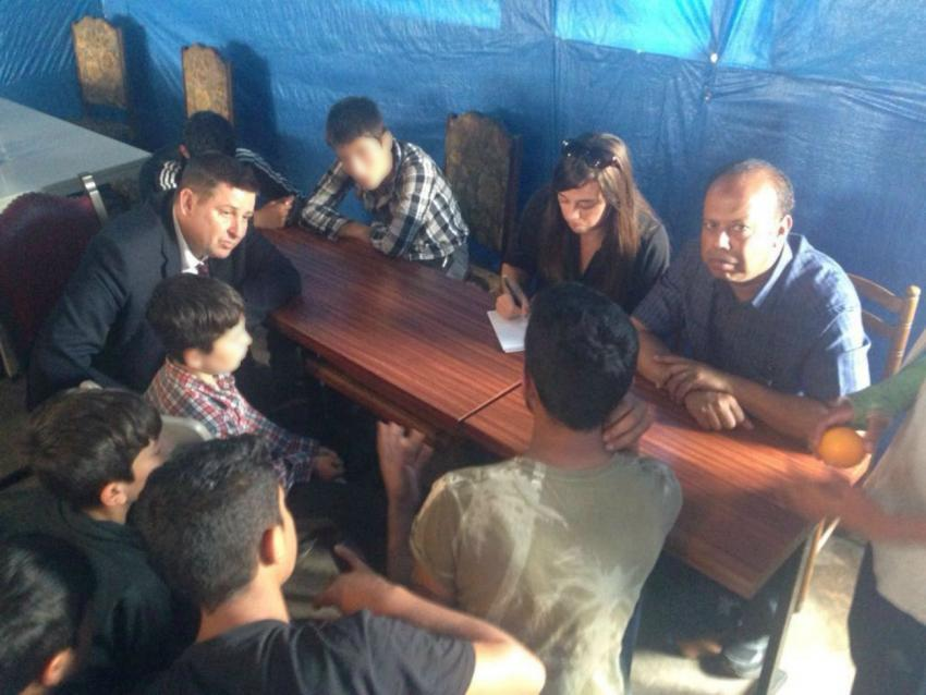 Cllr Stephen Cowan talks to child refugees in Calais