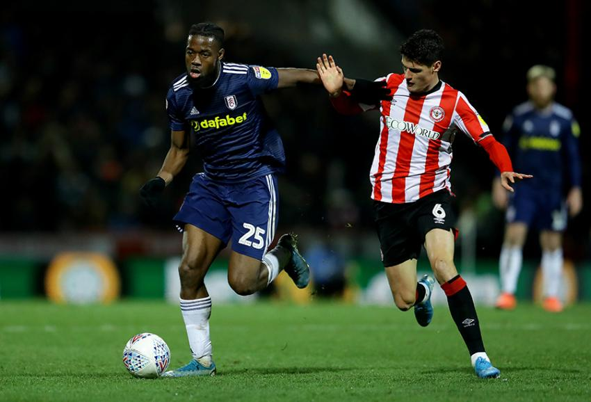 Christian Nørgaard of Brentford FC and Fulham FC's Josh Onomah duelling for the ball