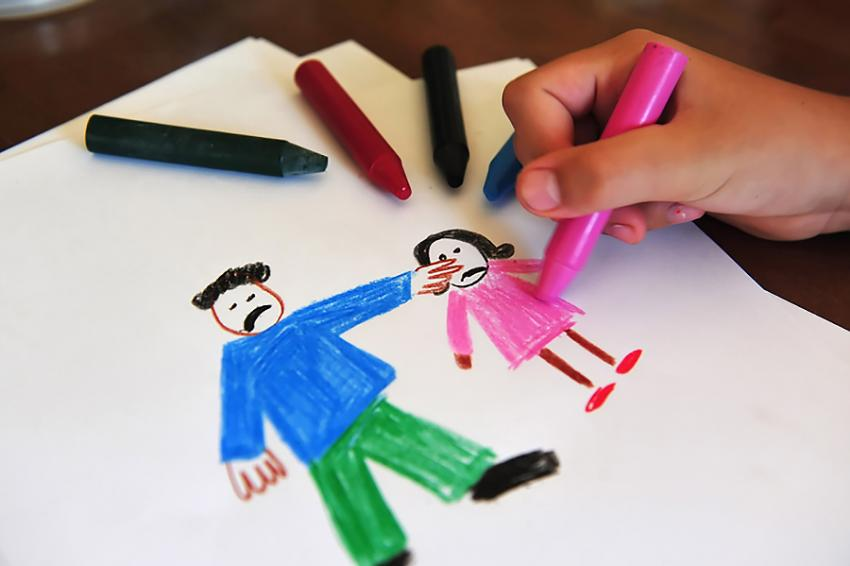 A children's drawing with crayons and paper