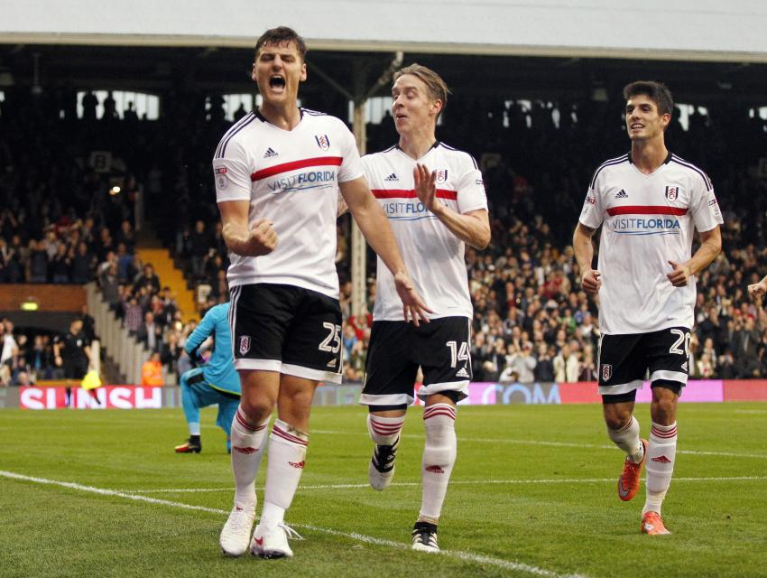 Fulham's Chris Martin celebrates their fourth goal with team mates Mandatory Credit: Action Images / Tom Jacobs