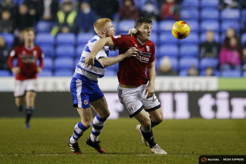 Fulham's Chris Martin in action with Reading's Paul McShane Mandatory Credit: Action Images