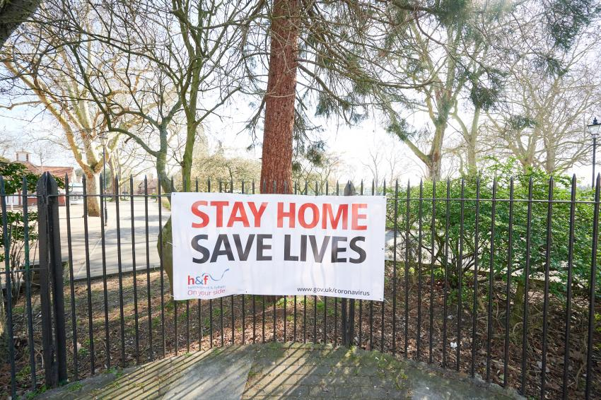 Stay Home Save Lives banner outside an H&F park