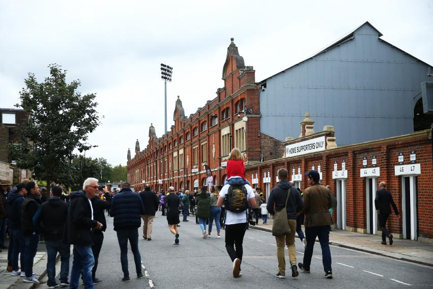 Fans on their way to a game to Craven Cottage football ground