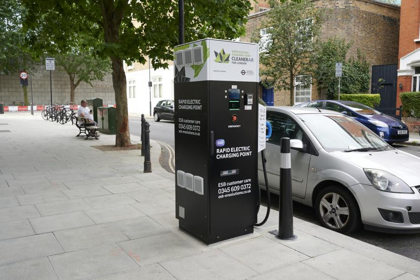 Rapid-charging unit on the kerbside with an adjacent car on the roadside