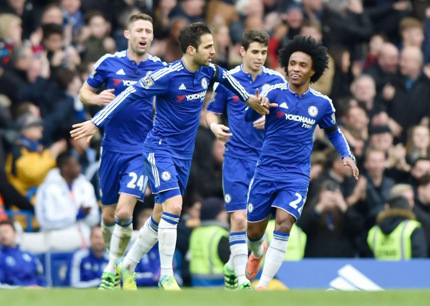 Cesc Fabregas celebrates with teammates after scoring the first goal for Chelsea against West Ham from a free kick. Picture: Action Images