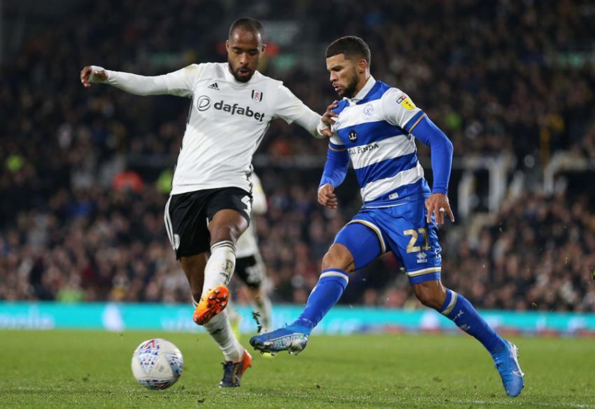 Fulham defender Denis Odoi and QPR striker Nahki Wells going for the ball