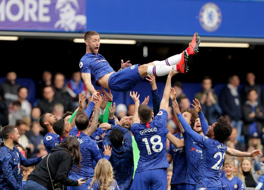 Gary Cahill of Chelsea is thrown up in the air by his team mates