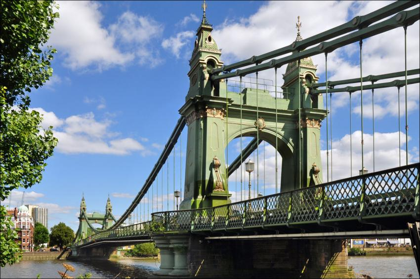 Hammersmith Bridge from the south in front of a blue sky