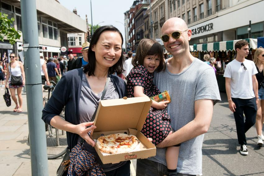 Family with pizza at Hammersmith Market
