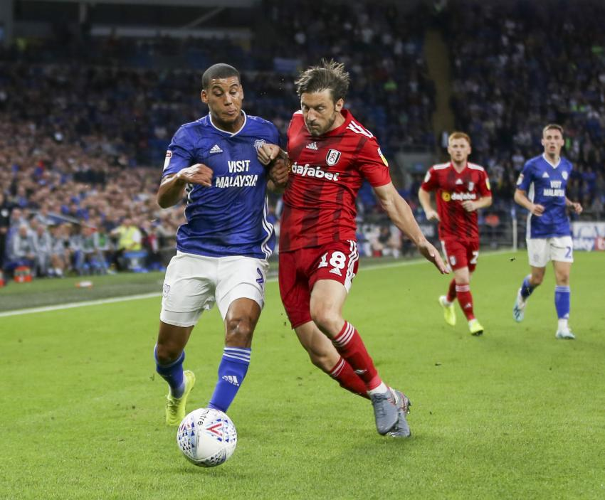 Harry Arter of Fulham and Lee Peltier of Cardiff City