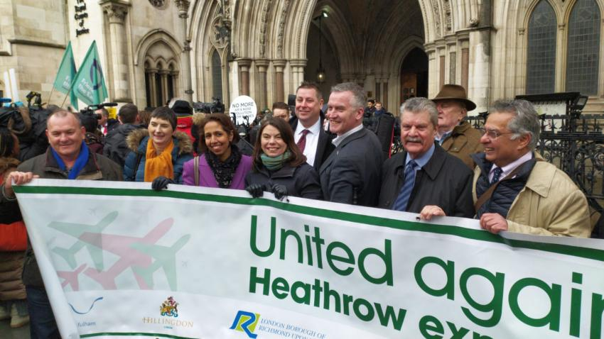 Anti-Heathrow third runway campaigners gathered outside the Royal Courts of Justice