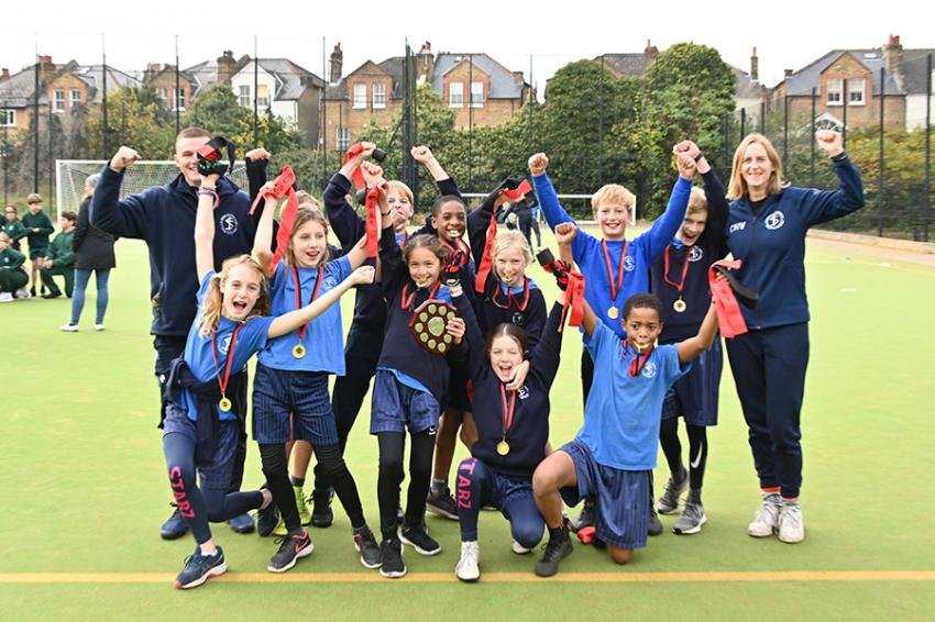 Children and teachers from St Stephen's Church of England Primary School celebrating their tag rugby cup win
