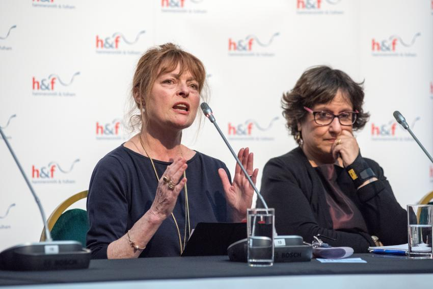 Janet Ellis sat at a table for International Women's Day in 2019