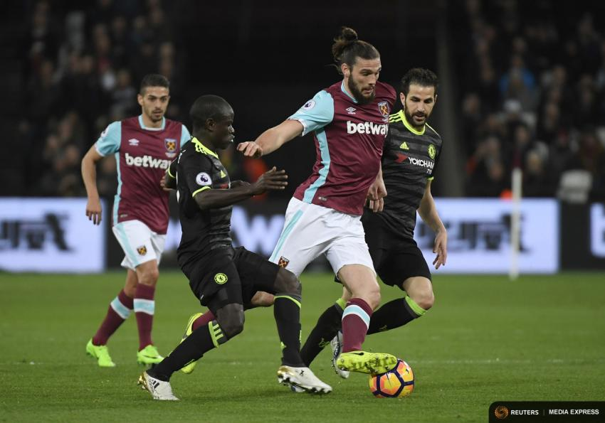West Ham United's Andy Carroll in action with Chelsea's N'Golo Kante and Cesc Fabregas