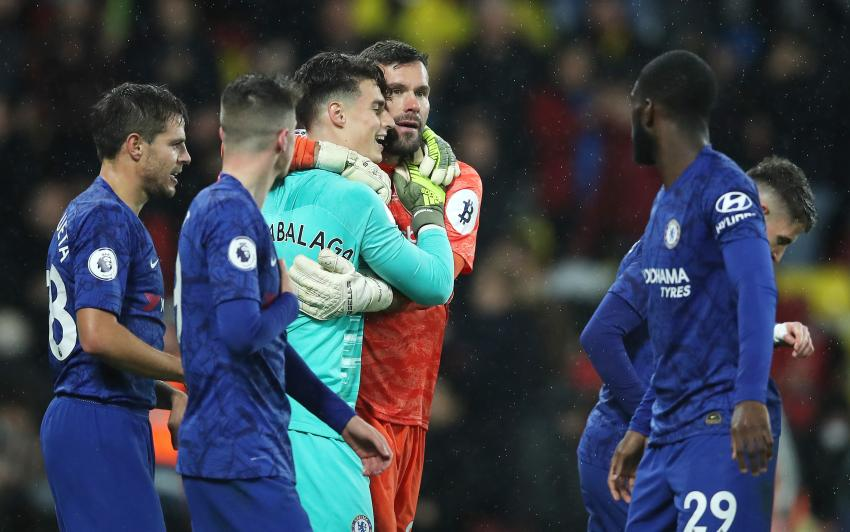 The goalkeepers of Chelsea and Watford embrace each other