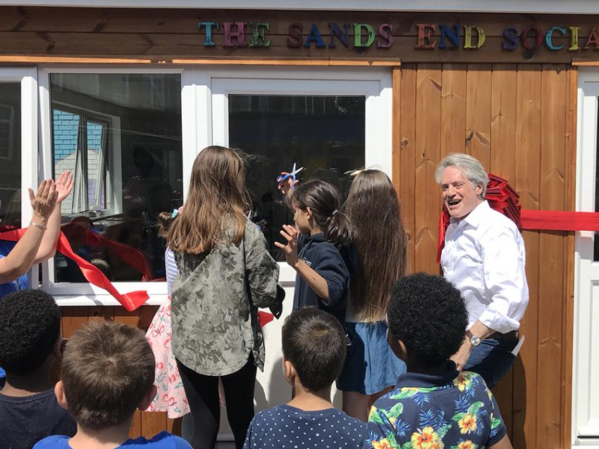 Kids cut ribbon to open the Sands End social shack