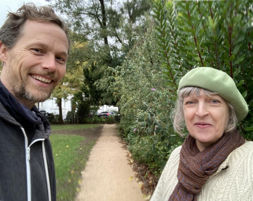 Leo Murray and Bridget Miles stood facing each other in Westcroft Square with one of the paths inbetween them