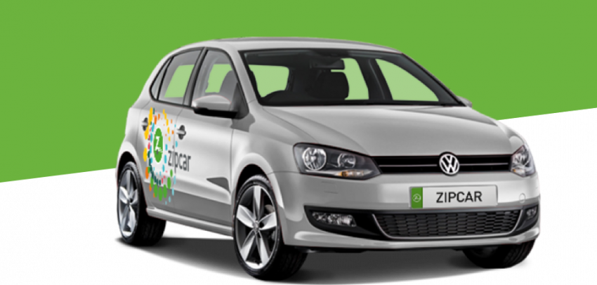Silver car with Zipcar branding on the doors