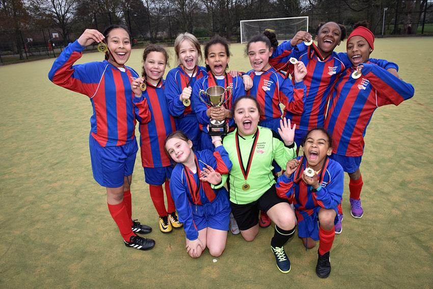 Melcombe primary school raise the 2019 girls' Mayor's Cup aloft