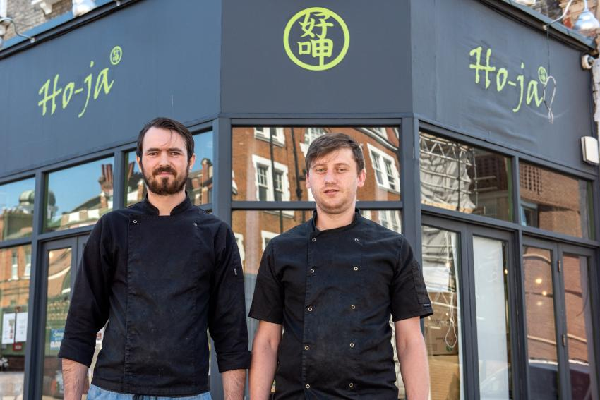 Two Ho-ja chefs stood outside their Taiwanese street food restaurant