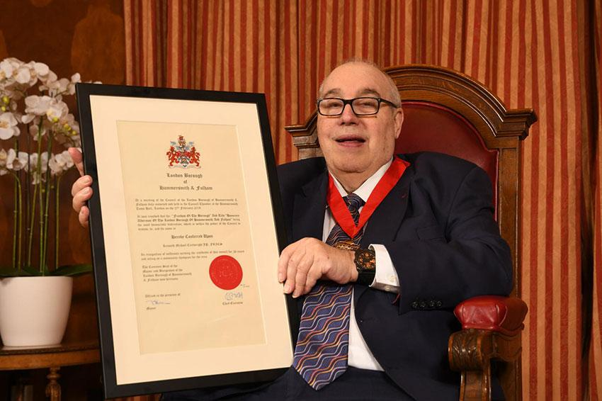 Mike Cartwright holding certificate showing he has the Freedom of the Borough