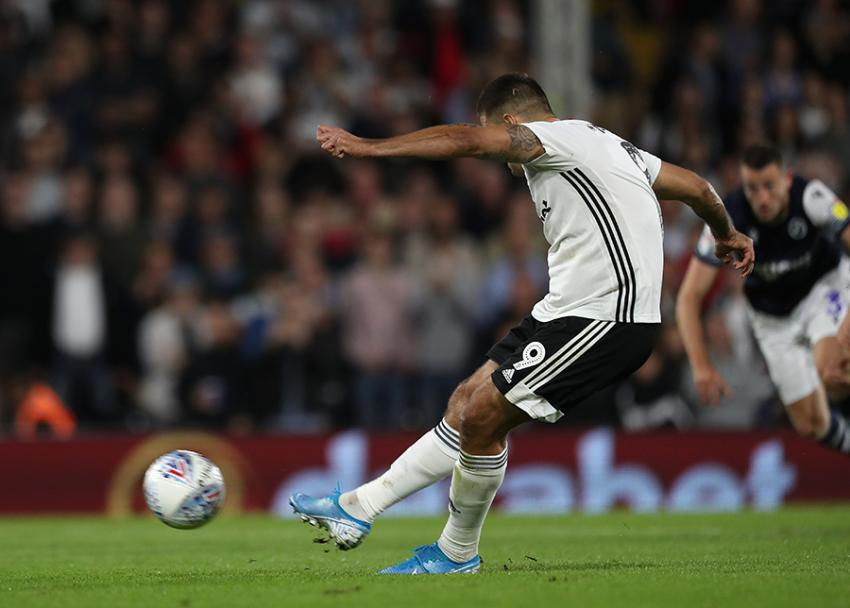Aleksandar Mitrovic scores a penalty for Fulham against Millwall