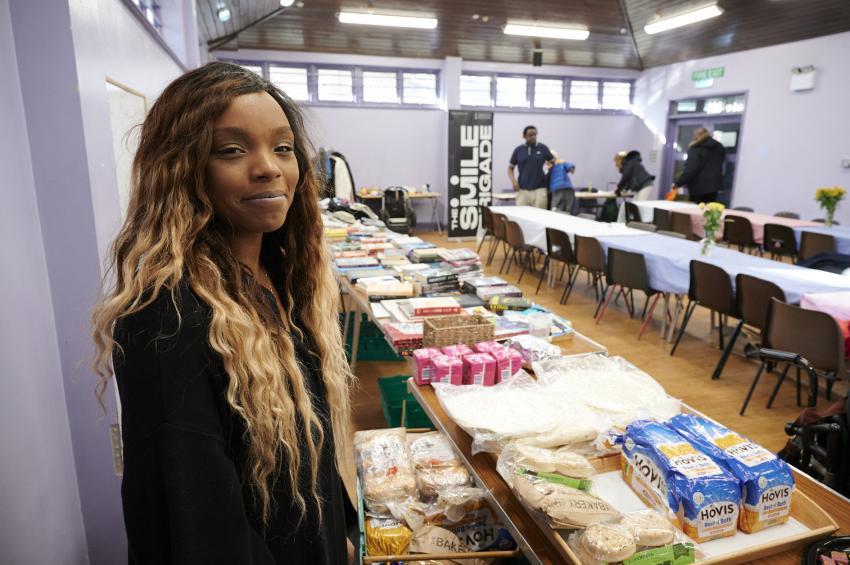 Monique Newton inside the Smile Brigade's base preparing food deliveries