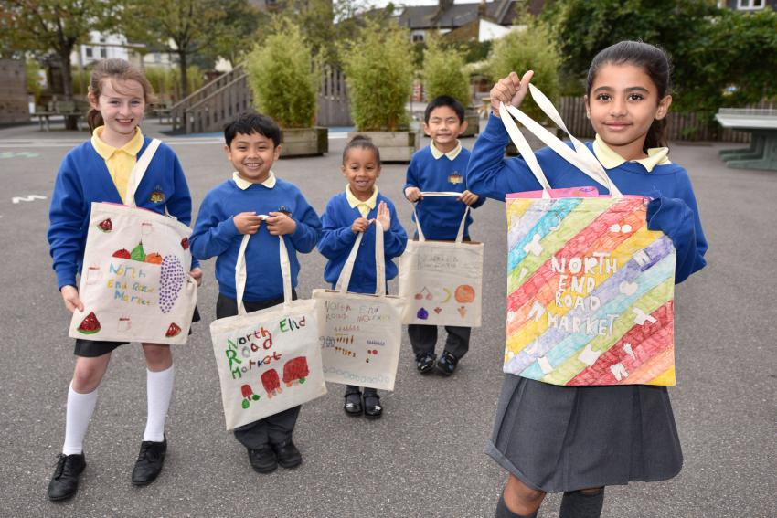 The young artists proudly display their bags