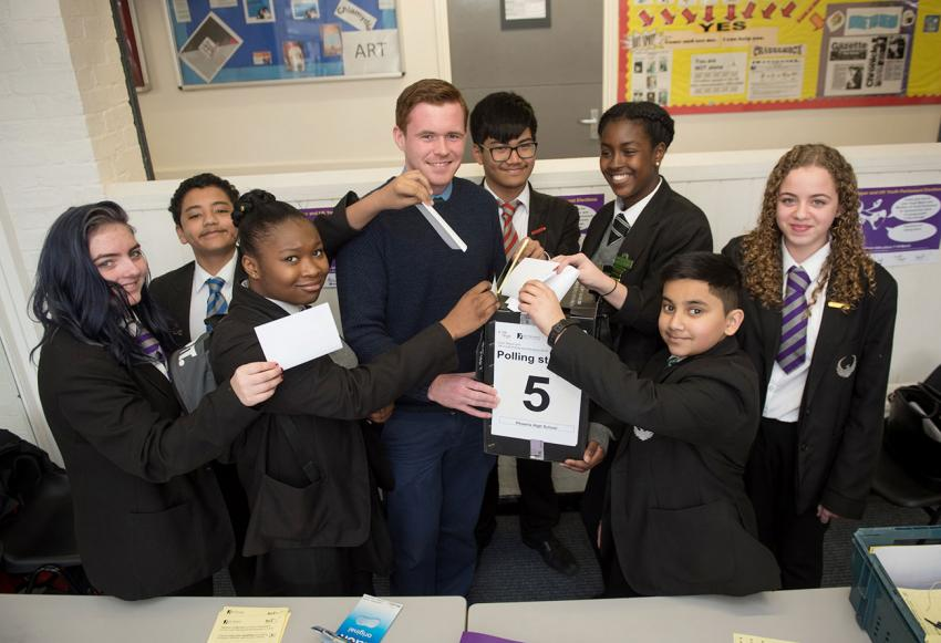 Phoenix pupils Noura Sonogo, Markie McNally-Boyde, Fahim Abdul, Tia Strong-Channer, John Jalocon and Gordana Stevanovic cast their votes. Phoenix teacher Larry Culhane (centre left) and Young Mayor candidate Aminata Koroma (centre right)