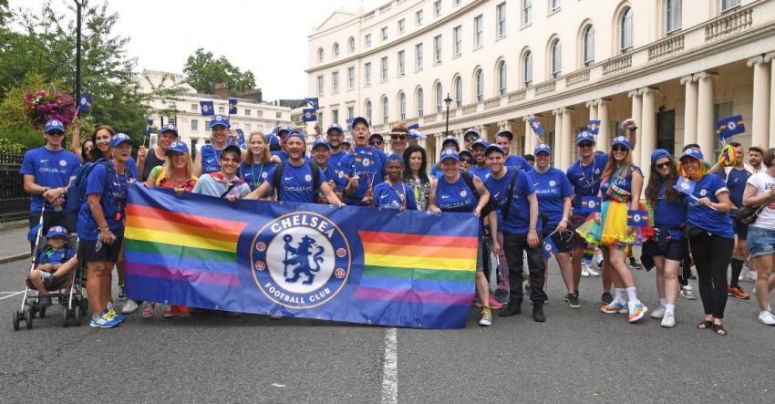 Chelsea FC fans displaying a rainbow Chelsea flag