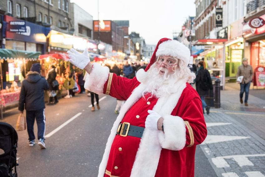 Santa Claus welcoming visitors to the Christmas market